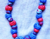 Goddess And Skull Stretchy Polymer Clay Necklace