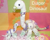 Learn how to make these Diaper Dinosaurs. Instructions for great baby gift, diaper cake. How to...