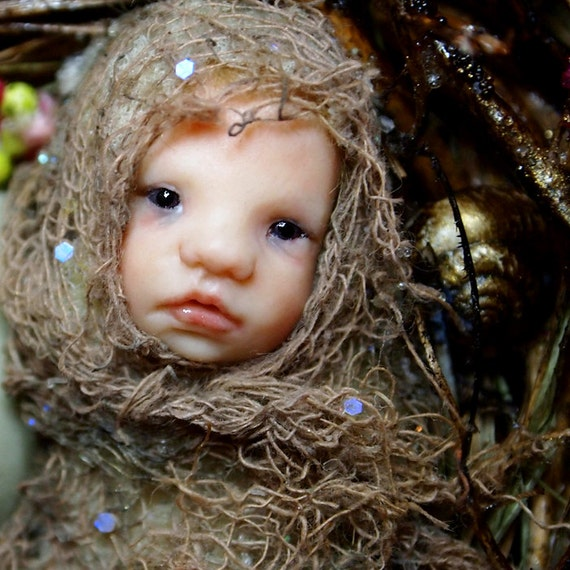 Hand-sculpted OOAK fairy on toadstool art doll sculpture