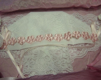 White Christening or Baptizmal Bonnet with Pink ribbon  The Magic Hanky card included.  Small