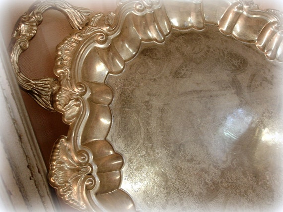 lovely vintage footed silverplated bridal tray with patina . generous size . delicate etched design with low scrolled wall with handles