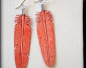 coral red leather feather earrings