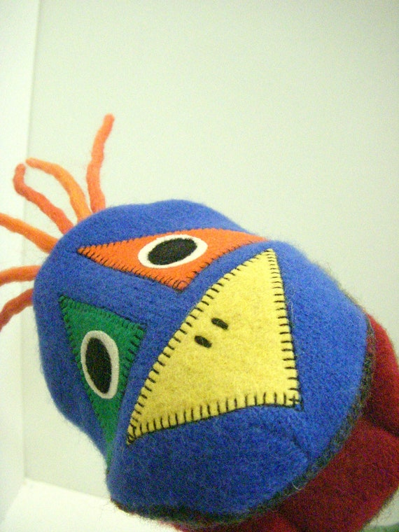 Tomato the bird hand puppet made of seven recycled wool sweaters