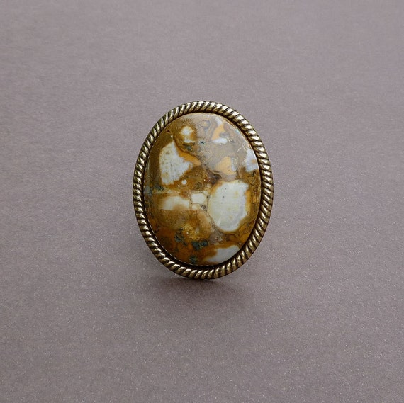 the perfect cocktail ring in eagle eye agate and gold statement ring