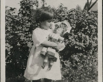 vintage photo Little Girl Holds big Doll