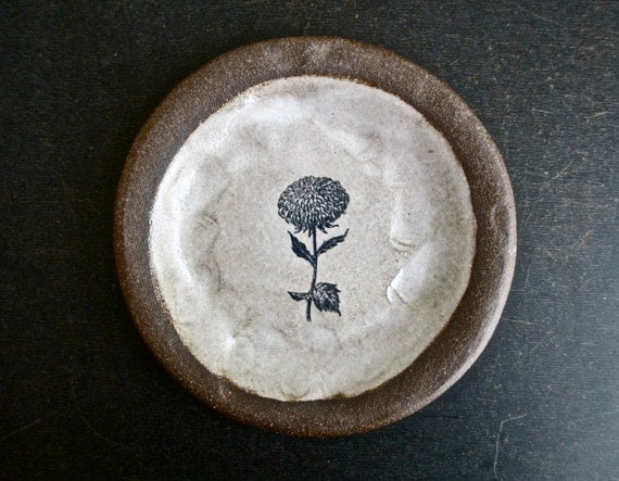 brown plate with a FLOWER.