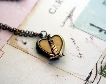 the lighthouse. locket necklace.brass ox