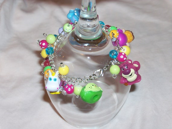 TOY STORY 3 chunky charm bracelet - trixie buttercup dolly lotso, peas and other funky beads charms - OOAK