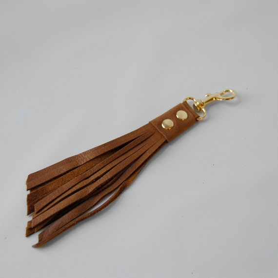 clip on tassel in whiskey/gold hardware