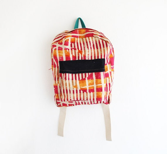 Orange and magenta abstract burlap backpack with denim pouch