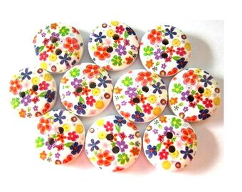 10 Wood buttons 15mm small flowers in assorted colors on white surface