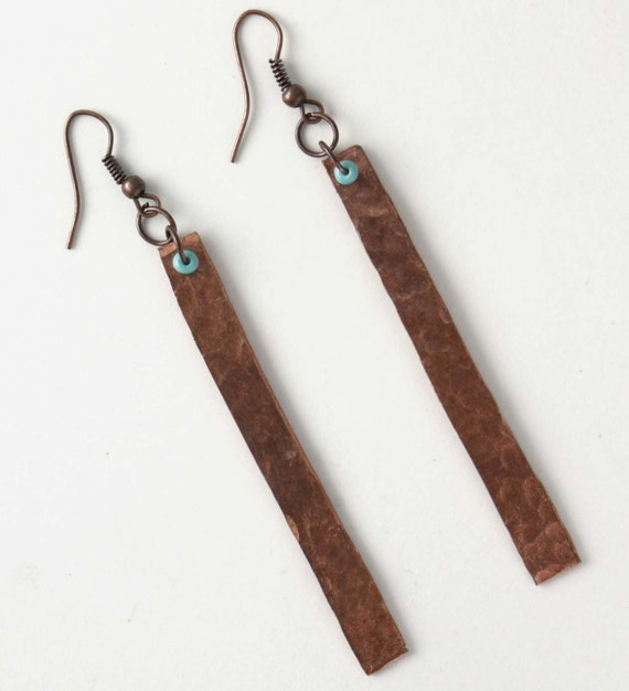 hammered copper earrings with turquoise beads.