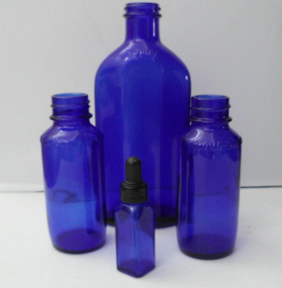 Vintage cobalt blue glass bottles medicine bottles by for Retro glass bottles