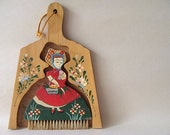 vintage handpainted wooden broom and dust pan in the shape of a lady in her garden