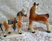 Horses - two small China Horses - One with Saddle - Vintage collector
