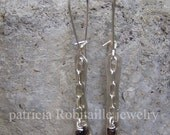 Dangling hand forged sterling silver, chain and garnet pierced earrings