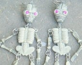 Jointed Skeleton Earrings.  Pink Eyes