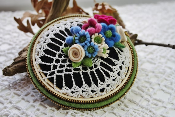 Embroidery hoop and vintage doily pin cushion