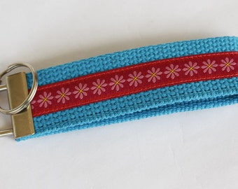 "Key Fob ""Pink Daisies"" on turquoise webbing"