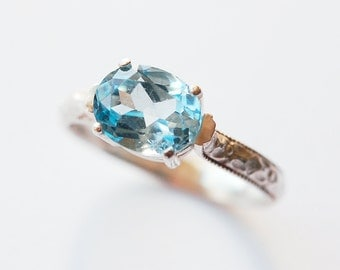Oval Blue Topaz and Silver Faceted Gemstone Ring Size 7 1/2