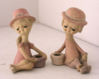 Pair of children figurines