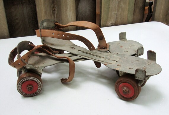 RESERVED for OldTechBiz -- Vintage Metal Roller Skates with Red Wheel Accents, for Display or Photography Prop
