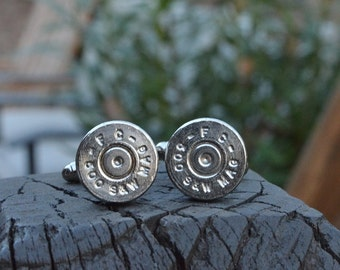 Bullet cufflinks fashioned from repurposed nickel silver Federal 500 S&W Magnum shell casings