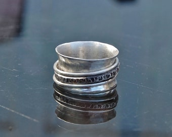 """Hand-crafted, hammered, wide band (1/2 inch) sterling silver ring has 3 sterling spinners, one is hammered and oxidized """"spinner ring"""""""