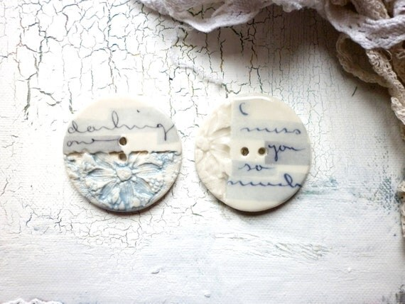 Love letters, A set of two large porcelain buttons