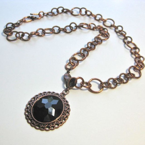 Statement necklace of copper chain with copper and black pendant