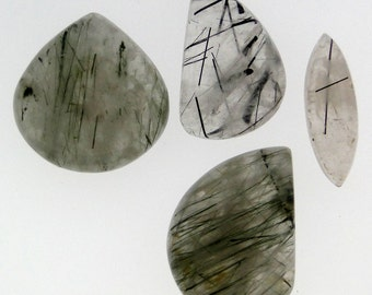 4 Black Rutile Quartz cabochons, various shapes, 124.36 carats total                     069-18-007