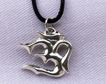 Stylized Om in sterling silver