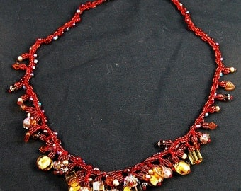 topaz tipped flame twisted cord necklace