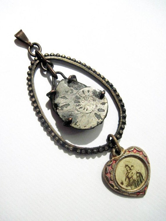 The Deepest Experience. Ammonites Fossil with Virgin Mary Medal.