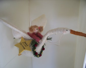 Baby Girl's on Flying Swan First Christmas Wool Ornament
