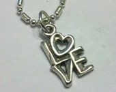 Sterling Silver Love Pendant Charm on a 16 1/2 inch SP Chain