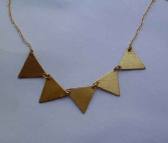 Bunting necklace in gold and brass