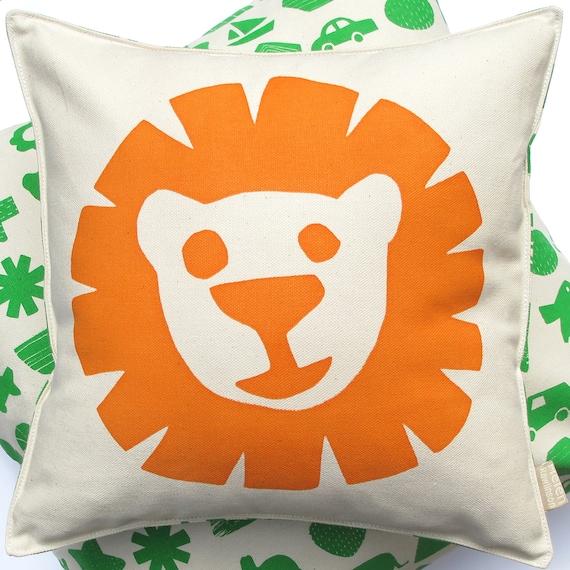 Lion cushion in organic cotton in orange