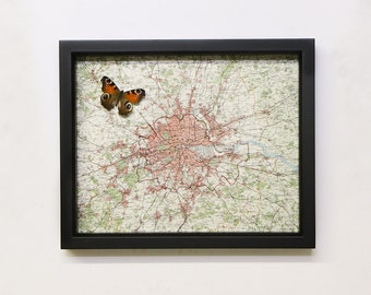 Old map of London with real framed butterfly