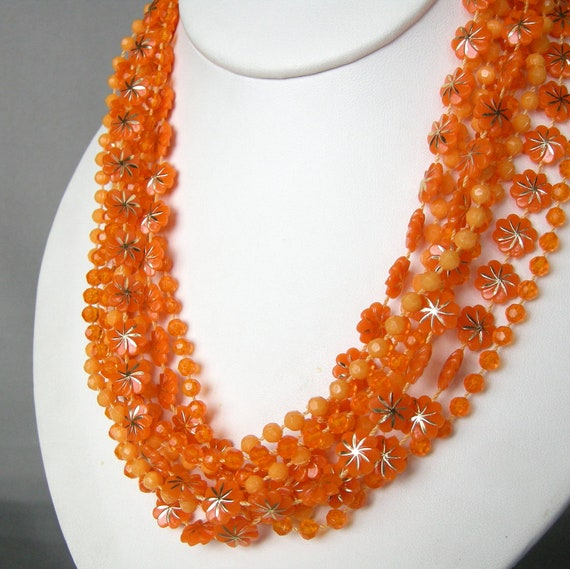 Long vintage orange plastic beaded necklace with three separate strands