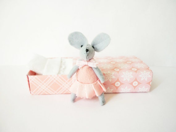 Pink mouse plush in matchbox bed