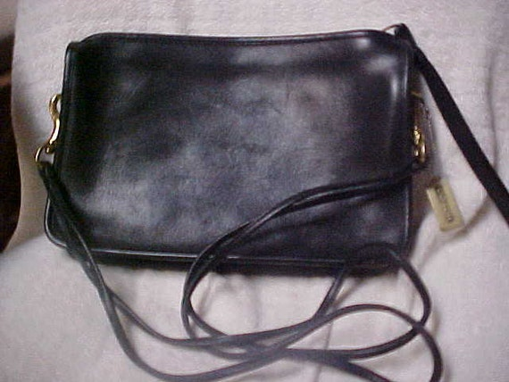 Black leather Coach shoulder bag-clutch-cross body purse-size 11X7X2 inches