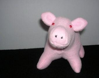 Small pink fleece pig