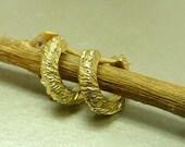 Gold huggie earrings. 14k gold  Hoop earrings