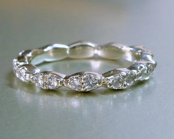 Diamond engagement or wedding band. 14k gold.  Eternity band.