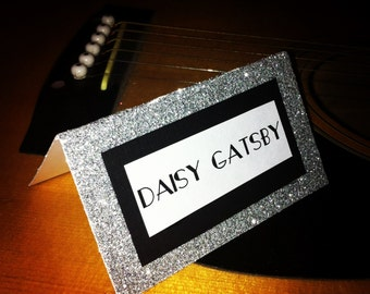 Silver and Black glittered place cards shown with gatsby inspired font, for parties, wedding, anywhere you are using placecards