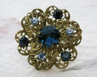 Vintage Brass Filigree and Blue Rhinestone Brooch