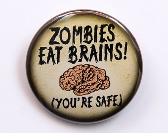 Zombies Eat Brains You're Safe - Button Pinback Badge 1 1/2 inch 1.5 - Flatback Magnet or Keychain