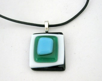 Berry turquoise emerald glass pendant on black leather necklace