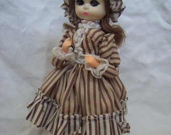 Vintage Bradley doll, Labeled Honey. colonial style costume.